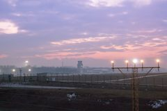 View of the airport and air traffic control tower against the be. Autiful blue red sky at sunset Stock Images