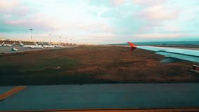 View of the airport from the plane window early in the morning stock footage