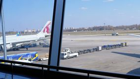 View of the Airport Runway with Aircraft and Support Staff. BORYSPIL, UKRAINE, APRIL 3, 2019: View of the Airport Runway with Aircraft and Support Staff. View stock footage