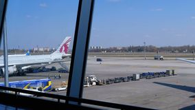 View of the Airport Runway with Aircraft and Support Staff. Boryspil, Ukraine, April 3, 2019: View of the Airport Runway with Aircraft and Support Staff. View stock video
