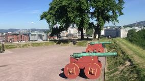View from Akershus Fortress in Oslo Town Hall and historic cannons. Located on Akershus Fortress, Norway, Scandinavia stock video footage
