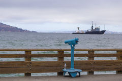 View of Alcatraz prison and shipping vessels during a stormy day in San Francisco, California Stock Photos