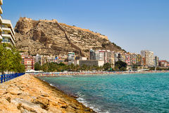 A view at Alicante's castle Santa Barbara from the seaside. Stock Photography