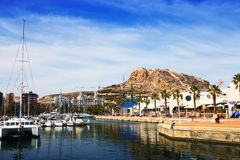 View of Alicante with yachts at sea and restaurants Royalty Free Stock Photography