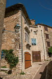 View of alley with stone houses on a blue sunny day in Saint-Paul-de-Vence. Royalty Free Stock Photos