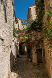 View of alley with stone houses on a blue sunny day in Saint-Paul-de-Vence. Stock Photo