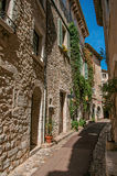 View of alley with stone houses on a blue sunny day in Saint-Paul-de-Vence. Stock Image