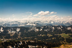View on the Allgäu Alpes from Hochgrat summit. View from Hochgrat in the Alps with snowy peaks on a spring morning in May and blue sky Stock Photos