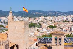 View of the Almudaina Palace with mountains in the background from the terrace of the Cathedral of Santa Maria of Palma. Also known as La Seu. Palma, Mallorca Stock Photography
