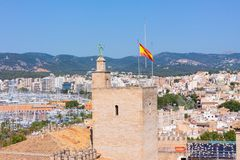 View of the Almudaina Palace with mountains in the background from the terrace of the Cathedral of Santa Maria of Palma. Also known as La Seu. Palma, Mallorca Royalty Free Stock Photography