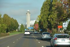 PDX Terminal and Air Traffic Control Tower, Portland, Oregon. This is the view along Airport Way of Portland International Airport`s PDX terminal and air traffic stock photo