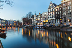 View along the Amsterdam Canals at twilight Royalty Free Stock Photo