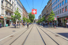 View along Bahnhofstrasse street in Zurich, Switzerland. Zurich, Switzerland - 26 May, 2016: view along Bahnhofstrasse street towards Zurich main train station Royalty Free Stock Photo