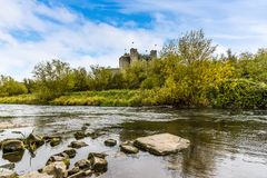 A view along the banks of the River Boyne at Trim, Ireland. Towards the castle on a sunny autumn day Royalty Free Stock Images