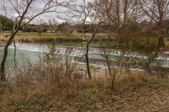 Blanco State Park 4. A view along the Blanco River as it flows over this dam at  Blanco State Park in Blanco, Texas. The clear river has a green color to it as stock photo