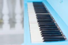 View along a blue piano keyboard Stock Image