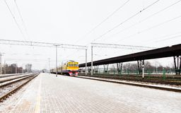 Riga Central Station as a Train Arrives. The view along a frosty platform at Riga Central Station as a train arrives.  The station is in the capital city of Royalty Free Stock Photos