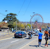 View along General Guisan quay in Zurich, Switzerland. Zurich, Switzerland - 11 April, 2016: traffic and joggers on General Guisan quay with the Ferris wheel royalty free stock photo