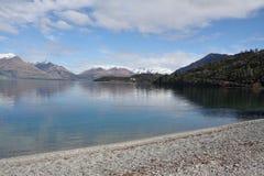 View along Lake Wakatipu in New Zealand. Stony beach on Lake Wakatipu in New Zealand Royalty Free Stock Photo