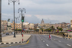 View along the Malecon, Havana Cuba. Evening view along the Malecon, Havana Cuba with the Capitolio in the distance Royalty Free Stock Photo