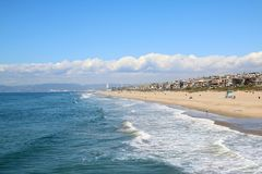 View along Manhattan Beach Los Angeles. The Manhattan Beach is popular with swimmers and surfers. Viewed here on a warm February day with sun sea and sand Stock Photo