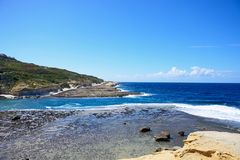 View along the Marsalforn coastline, Gozo. View along the coastline with rocks in shallow water in the foreground, Redoubt, Marsalforn, Gozo, Malta, Europe Stock Images