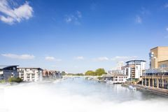 River view with buildings. View along misty River Thames Kingston Upon Thames Surrey England with buildings Stock Photo