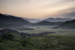 View along misty valley towards Snowdonia mountains Stock Photos