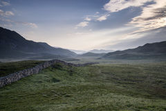 View along misty valley towards Snowdonia mountains Royalty Free Stock Photo