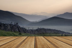View along misty valley towards Snowdonia mountains with wooden Royalty Free Stock Photo