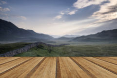 View along misty valley towards Snowdonia mountains with wooden Stock Photography