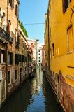 Narrow venetian canal on a sunny day. A view along a Narrow venetian canal on a sunny day Stock Photo