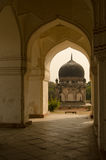 Arches at Seven Tombs, Hyderabad. View along the outer wall of Hayath Bakshi Begum Tomb, part of the Mughal Empire Qutb Shahi Tombs in Hyderabad, India Royalty Free Stock Photography