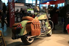 View along the right side of motorcycle Indian Chief Vintage 2017 willow green / ivory cream. Time of the International motorcycle industry salon IMIS2018 stock photography