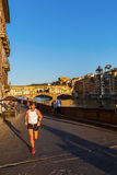 View along the river Arno to the Ponte Vecchio in Florence, Italy stock images