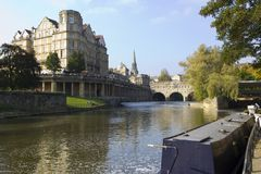 Picturesque Bath. View along the River Avon towards famous Pulteney Bridge, Bath, UK Royalty Free Stock Photo