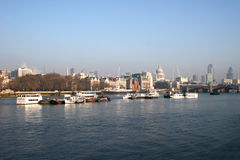 View along River Thames. Looking east along River Thames, London to St Pauls cathedral Stock Image