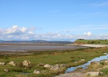 Shoreline of Morecambe Bay, Hest Bank Lancashire. View along the shoreline of Morecambe Bay at Hest Bank in Lancashire on a sunny day at low tide looking stock photo