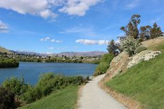 Track by Frankton Arm, Lake Wakatipu, New Zealand. View along a track or footpath by the Frankton Arm of Lake Wakatipu, Otago, South Island, New Zealand. with Royalty Free Stock Photos