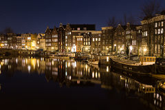 View along the Waalseilandgracht Canal in Amsterdam at night Royalty Free Stock Photo