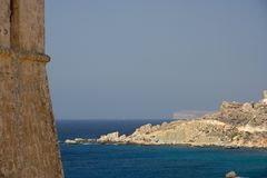 Watch Tower And Coast, Malta. View alongside a lookout tower in Malta, in the background the mighty cliffs of Ta`Cenc on Gozo Royalty Free Stock Photo
