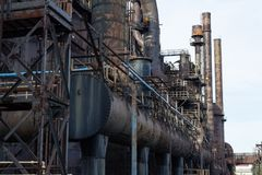 View alongside steel industry complex, smokestacks and heavy patina aging. Horizontal aspect stock image