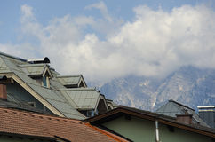 View of the alp mountains above the roof off Kitzbuhe Stock Images