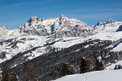 View of the Alpe di Fanes cliffs in winter, with the peaks Conturines and Piz Lavarella, Alta Badia, Italian Dolomites. Stock Photography