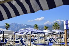 View on the Alpi Apuane from the beach of Versilia Mediterranea royalty free stock photography