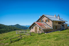 View of alpine mountain scenary with traditional old mountain chalet on a summer day. Dolomites mountains, South Tyrol, Italy Stock Photo