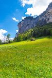 Chalets on green mountain slope. Swiss Alps. Lauterbrunnen, Swit Royalty Free Stock Photography