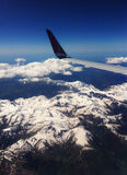 View of the alps. View of the French alps through the window of a plane Royalty Free Stock Photography