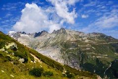 View through Alps valley near Gletch with Furka pass mountain ro Stock Photos