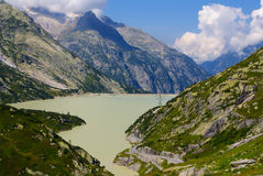 View through Alps valley near Gletch with Furka pass mountain ro Royalty Free Stock Image